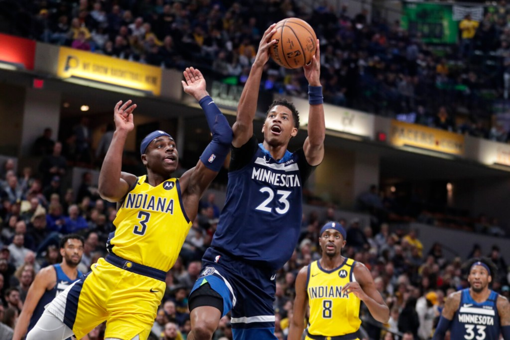 Timberwolves guard Jarrett Culver takes a shot while being defended by Indiana's  Aaron Holiday during Minnesota's 116-114 win on Friday in Indianapolis.