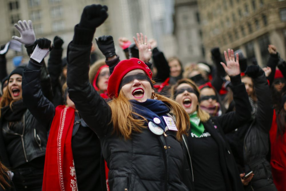Women take part in a rally before the Women's March on Saturday in New York. Several thousand came out for the protest in Washington, but it was far fewer than last year, when about 100,000 people held a rally east of the White House.