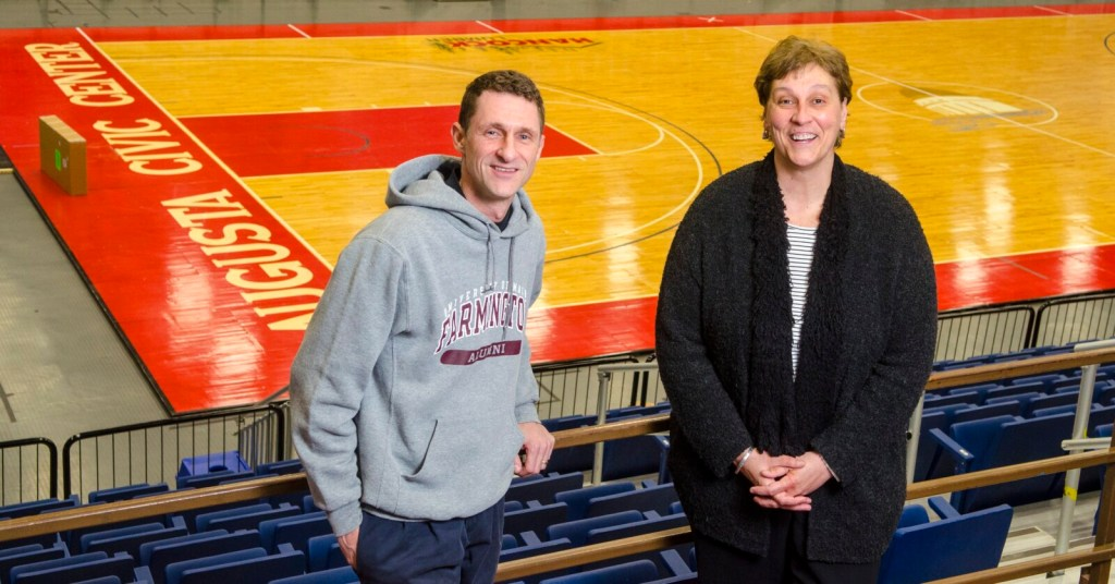 Former Hall-Dale basketball players Robbie Morin, left, and Rachel Bouchard pose inside the Augusta Civic Center on Tuesday afternoon. Morin and Bouchard still hold a number of tournament records. Bouchard, for example, set a South regional record with 109 points scored in the 1987 tournament. Morin owns the record for most 3-pointers in a boys South regional game (10, set in 1990).