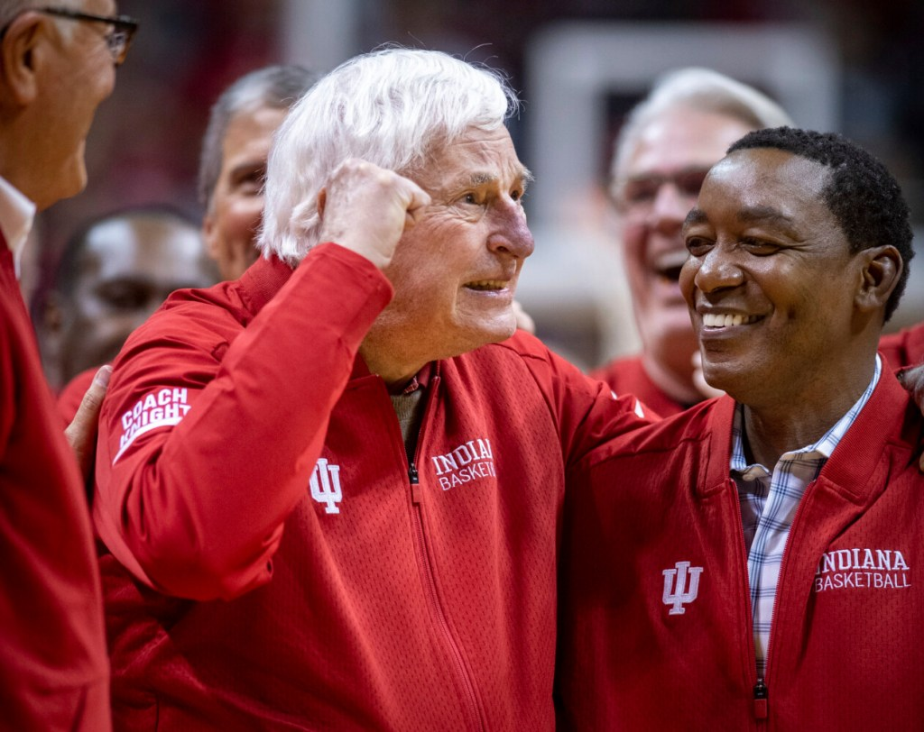 Former Indiana basketball coach Bobby Knight, left, makes his first appearance at Indiana University since his dismissal in September of 2000. Knight, along with former player Isiah Thomas, right, are on the court during a ceremony with the Indiana players of the 1980 Big Ten championship team Saturday in Bloomington, Ind.
