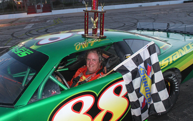 Jeff Taylor of Norridgewock smiles in victory lane at Oxford Plains Speedway last Sunday night. The nine-time track champion has won in both of his starts in 2020.