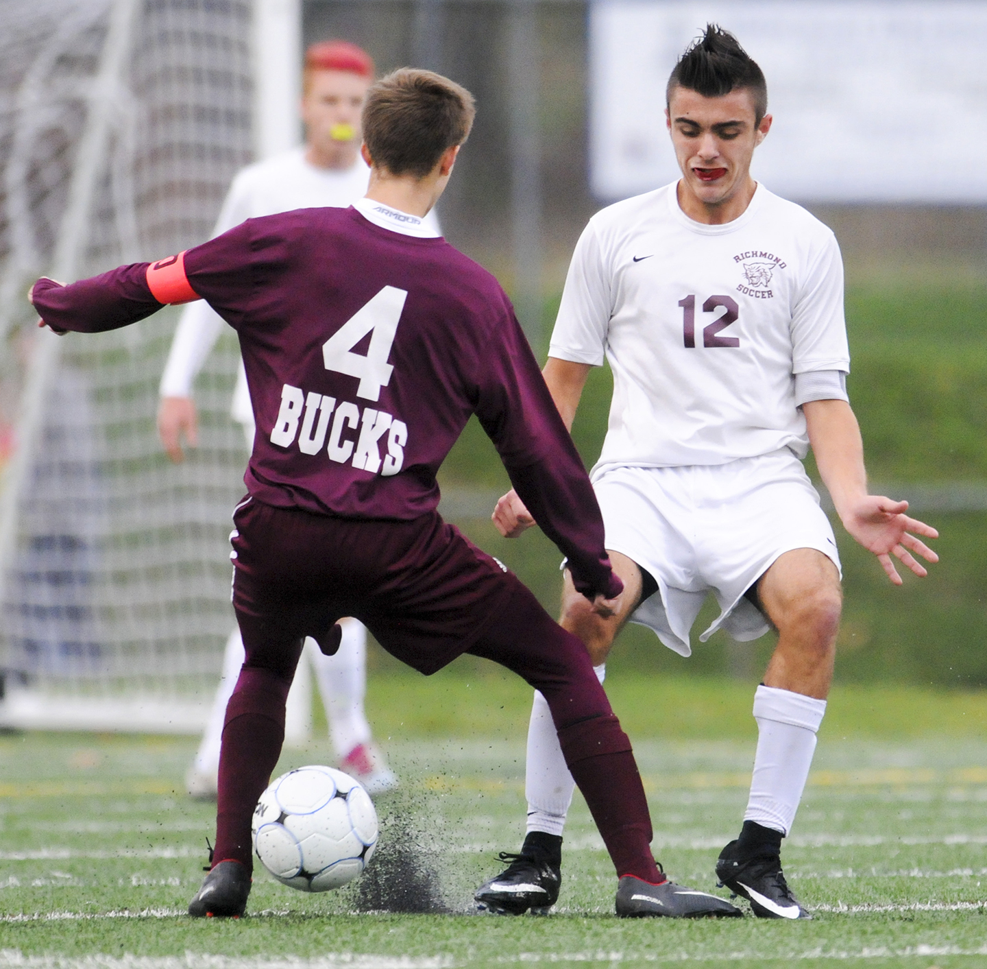 fe7334f05 Rubber chips from field turf pop up as Buckfield's Tobias Worthley, left,  and Richmond's Zach Small battle for a ball in the D South boys' soccer ...