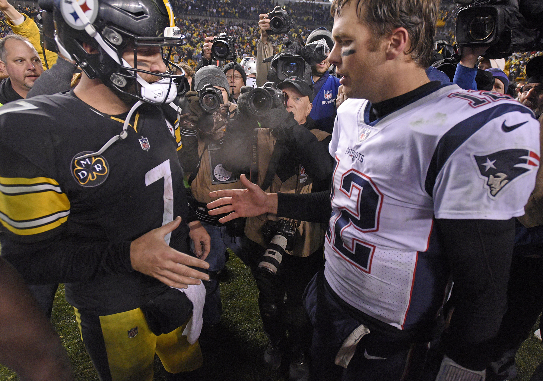 5199ccbf1d9 17, 2017, file photo, Pittsburgh Steelers quarterback Ben Roethlisberger (7)  and New England Patriots quarterback Tom Brady (12) meet on the field  following ...