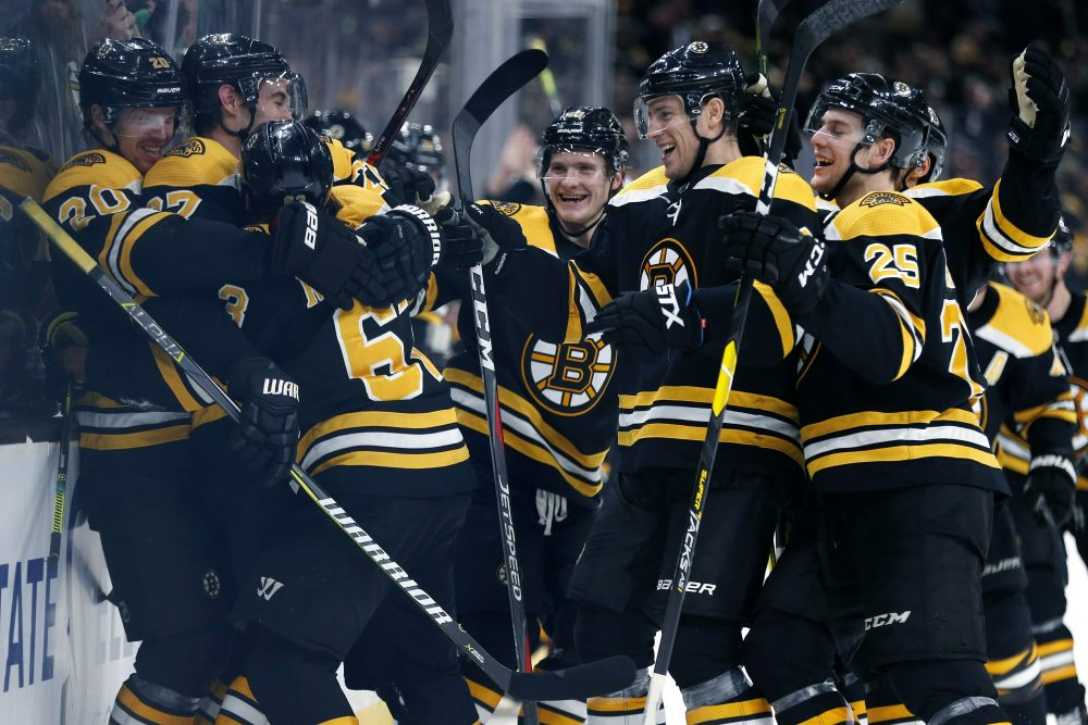 c0bb2735faa Boston Bruins celebrate after a goal by Brad Marchand (63) during overtime  in an NHL hockey game against the Columbus Blue Jackets in Boston,  Saturday, ...
