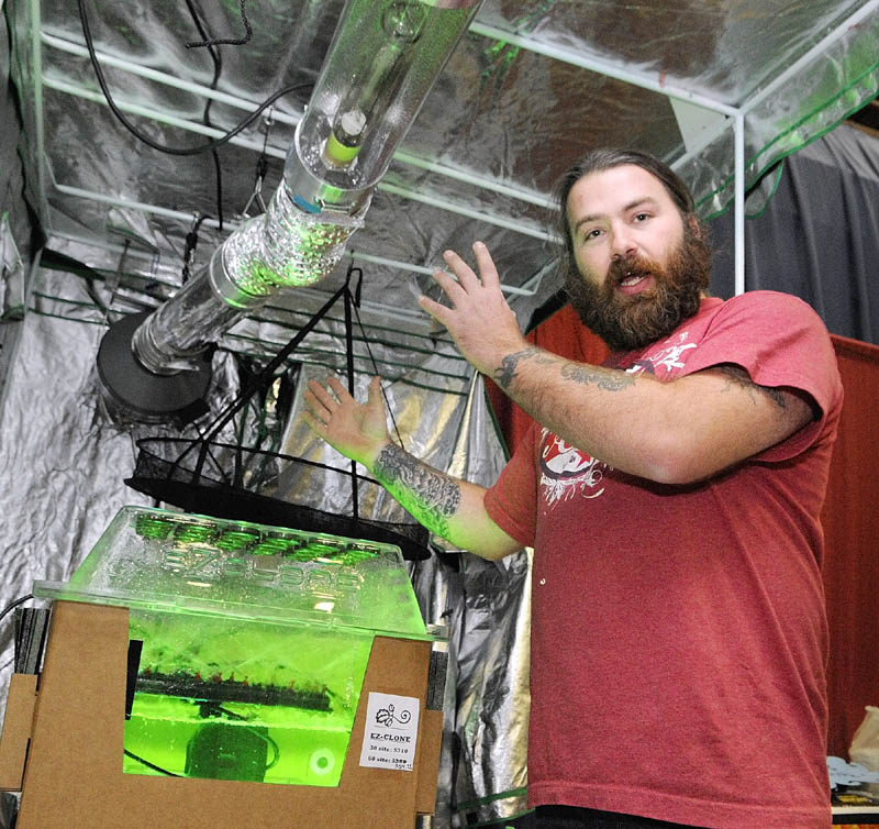 HIGH TECH MACHINE: Jake McClure, of the Medical Marijuana Caregivers of Maine, talks about indoor growing equipment in the Maine Hydroponics Supply booth during the Home Grown Maine trade show Saturday at the Augusta Civic Center.