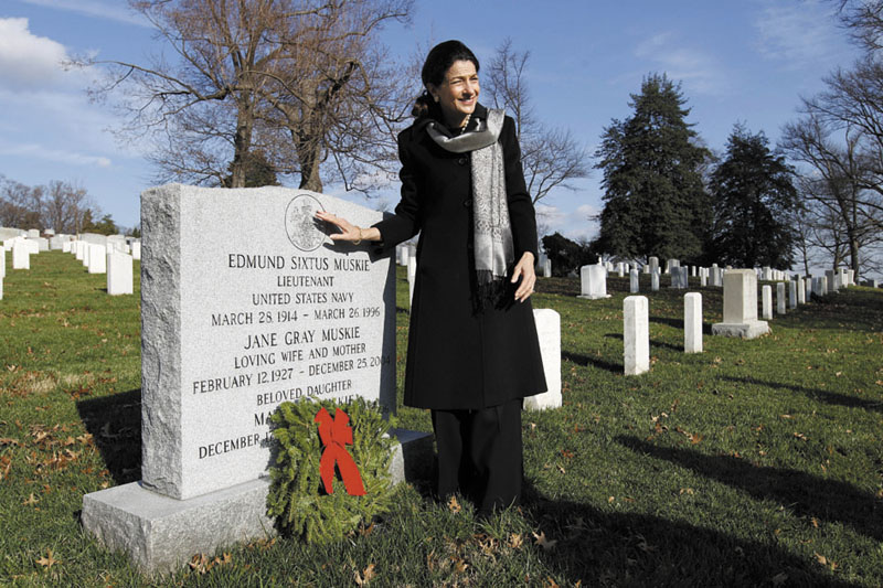 MEMORIAL: Sen. Olympia Snowe, R-Maine, places a holiday wreath on the grave of Edmund Muskie at Arlington National Cemetery in Washington on Saturday during Wreaths Across America Day. Muskie was a former Maine governor and a U.S. senator.