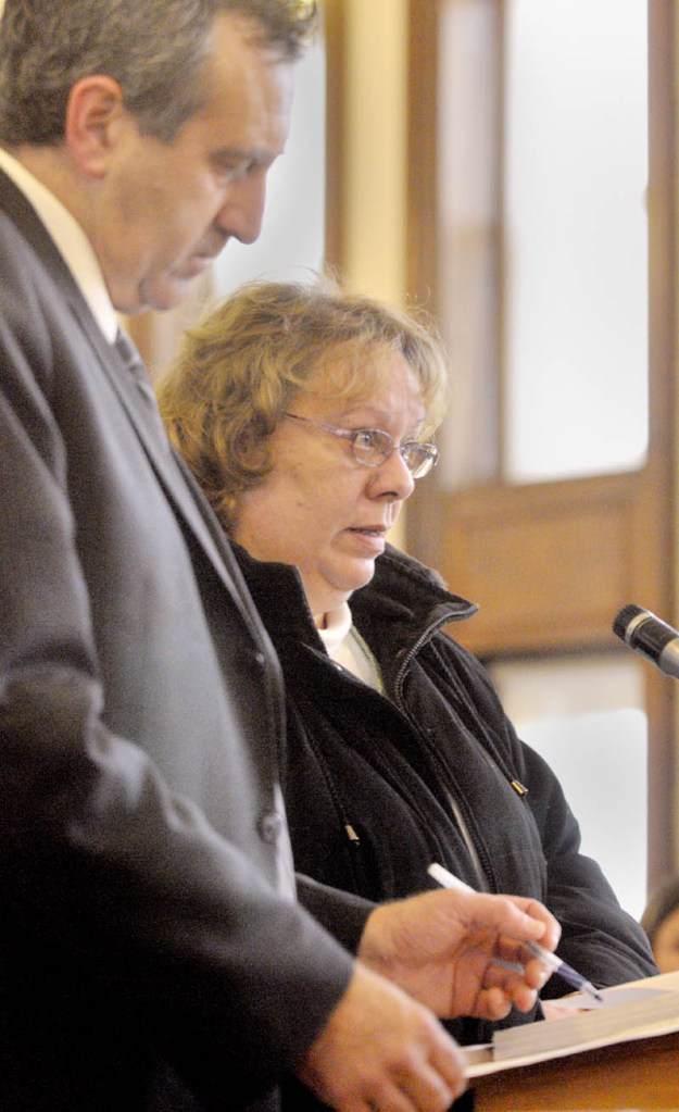 Bettysue Higgins stands with her attorney Ronald Bourget in Kennebec County Superior Court where she pleads guilty to embezzlement Wednesday morning.