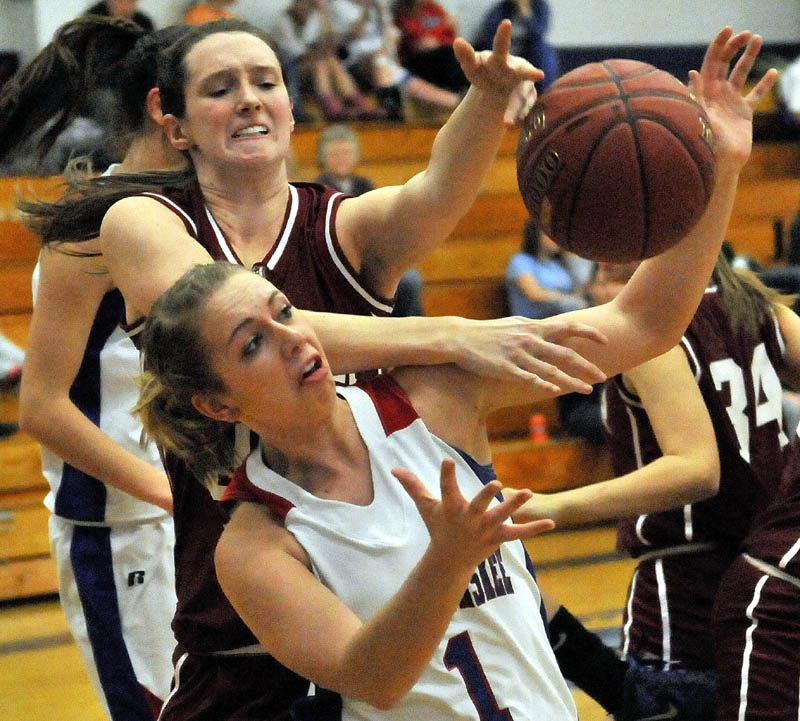 Messalonskee High School's Shelby Cutten, front, battles for the loose ball with Bangor High School's Katie Brochu during the first quarter Tuesday night at Messalonskee High School.