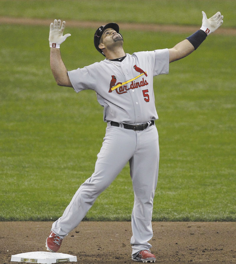 MAKE A DEAL: St. Louis Cardinals first baseman Albert Pujols agreed to a 10-year contract with the Anaheim Angels that will pay him $254 million. It is the second-highest contract in baseball history.