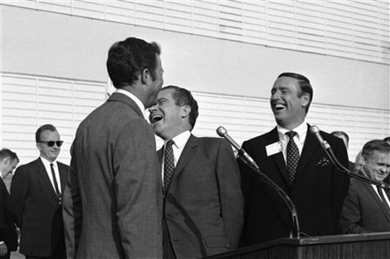 """In this Oct. 10, 1968 photo, Republican presidential candidate Richard Nixon, center, laughs at something comedian Dick Martin, right, says, during a rally in Burbank, Calif., Oct. 10, 1968. Some decidedly unfunny candidates have benefited by exceeding extremely low expectations when it comes to jokes. When Nixon went on the TV comedy show """"Rowan & Martin's Laugh-In"""" in 1968 and said """"Sock it to ME?"""" he got rave reviews. (AP Photo/File) campaigns,celebrities,celebrity,elections,entertainment,Laugh-In,laughing,politicians,politics"""