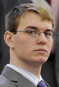 """In this April 9, 2012 photo,Thayne Ormsby sits in Superior Court, in Houlton, Maine. Ormsby on trial for the murder of three people told investigators that one of them was a drug dealer responsible for causing pain in his life and that the other two were """"perfectly innocent,"""" according to a videotaped interview with police. (AP Photo/The Bangor Daily News)"""