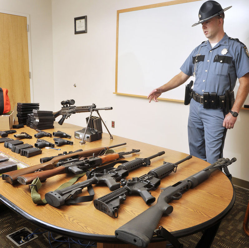 Maine State Police Trooper Philip Alexander seized several guns from Timothy Courtois of Biddeford following his arrest on a criminal speeding charge Sunday on the Maine Turnpike. A search of Courtois' home turned up additional weapons including a machine gun and boxes of ammunition.