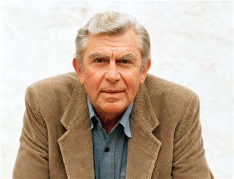 """This March 6, 1987 file photo shows actor Andy Griffith in Toluca Lake, Calif. Griffith, whose homespun mix of humor and wisdom made """"The Andy Griffith Show"""" an enduring TV favorite, died Tuesday, July 3, 2012. He was 86. (AP Photo/Doug Pizac, file) Actor;celebrity;hands;folded;posing"""