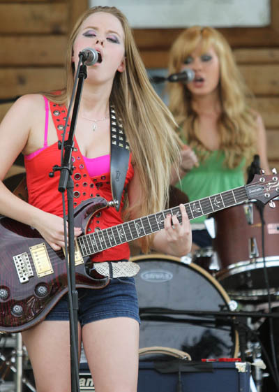 A SISTER ACT: The Veayo Twins perform at the 2nd annual Battle of the Bands at Fort Halifax Park in Winslow on Sunday. Kristen, front, and her 16-year-old twin sister Katherine, on drums, will be juniors this fall at Hall-Dale High School.