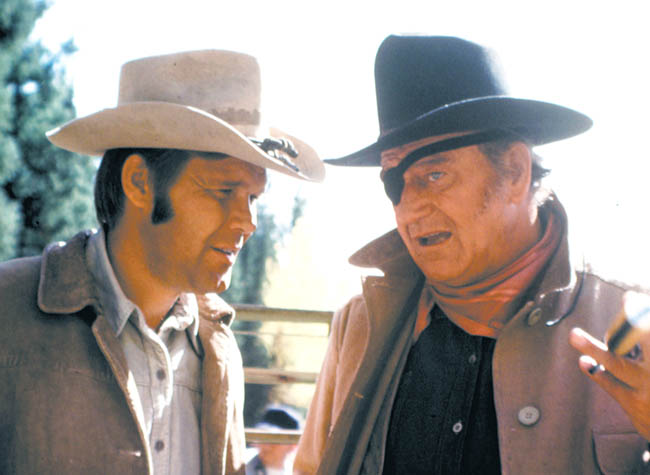 """Glen Campbell, left, in a scene from the movie """"True Grit"""" with John Wayne."""