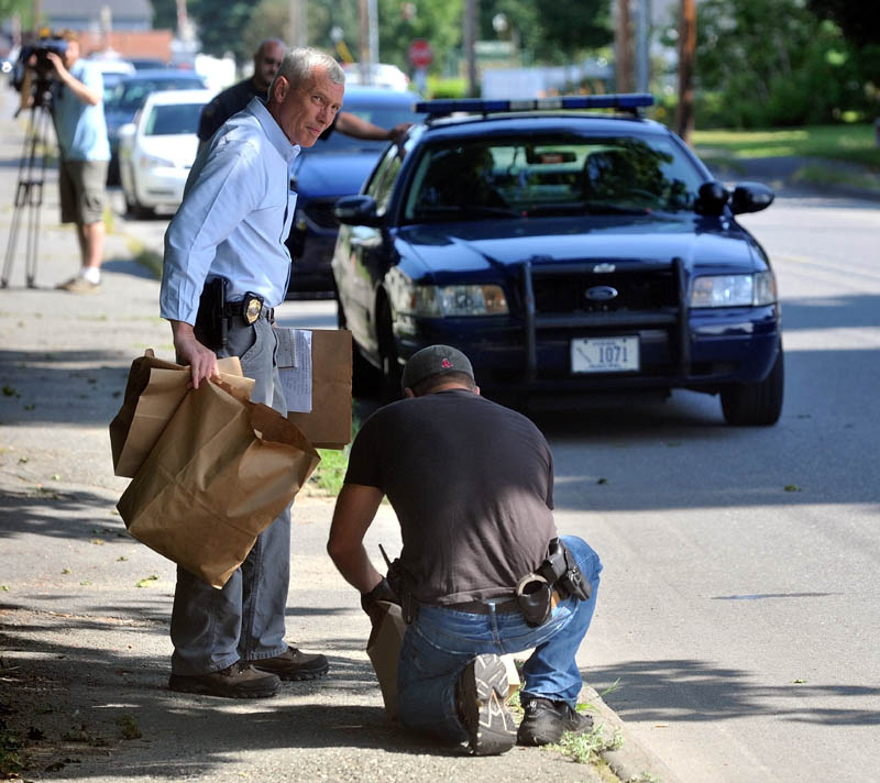 Waterville Police and Maine State Police collect evidence after they apprehended two suspects on Pleasant Street in Waterville in connection to a Rite Aid robbery this morning.