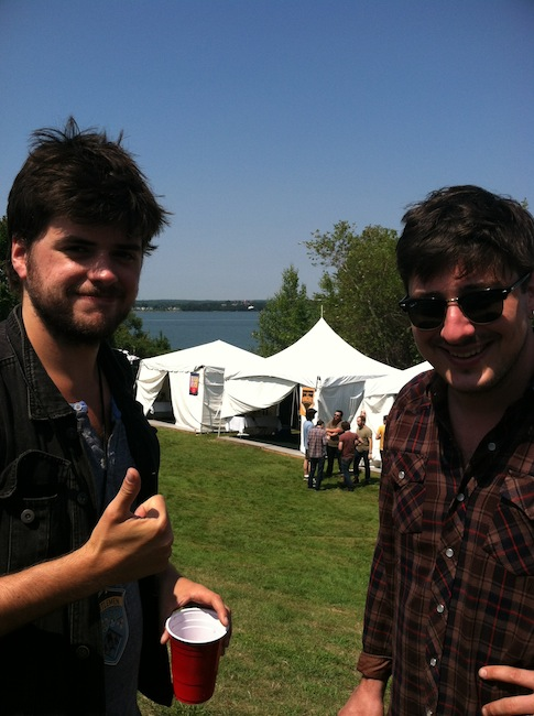 """Winston Marshall and Marcus Mumford from Mumford & Sons hang out backstage on the Eastern Promenade at the """"Gentlemen of the Road Stopover"""" music festival in Portland."""