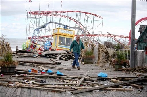Owner Billy Major surveys the damage to the Fun Town Pier in Seaside Heights on Wednesday. Only four of the rides on the pier survived Sandy.