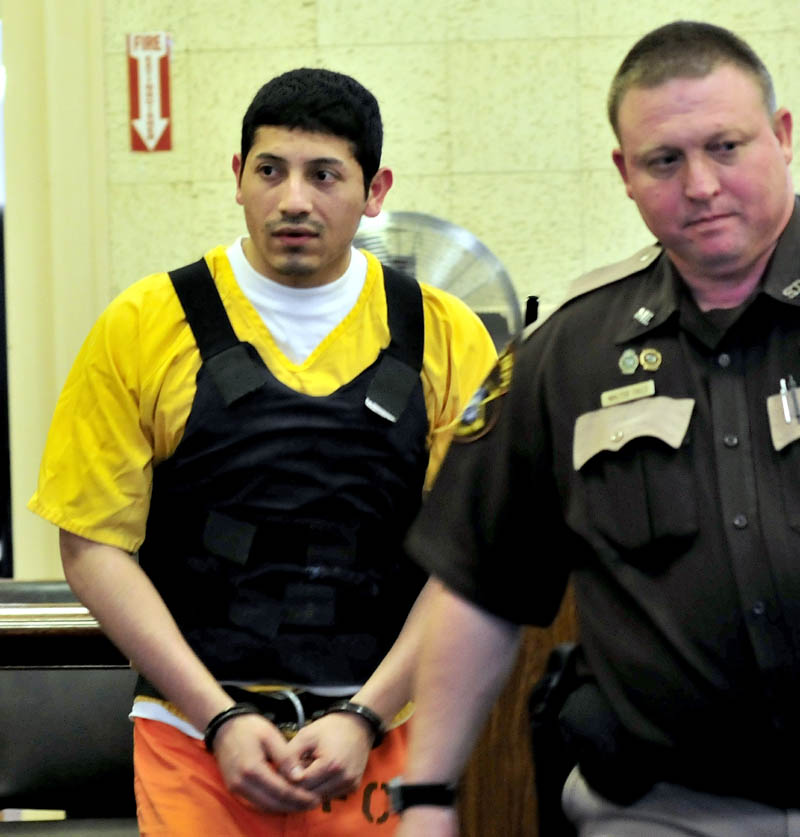 Juan Contreras is led into Franklin County Superior Court in Farmington Monday, the first day of his trial in the stabbing death of Grace Burton.