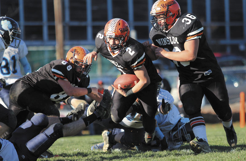 LOOKING FOR RUNNING ROOM: Winslow High School's Joseph Hopkins looks upfield for extra yardage after eluding several Dirigo High School defenders during the first half of the Black Raiders' 17-6 victory over the Cougars in the Western Maine Class C final on Saturday.