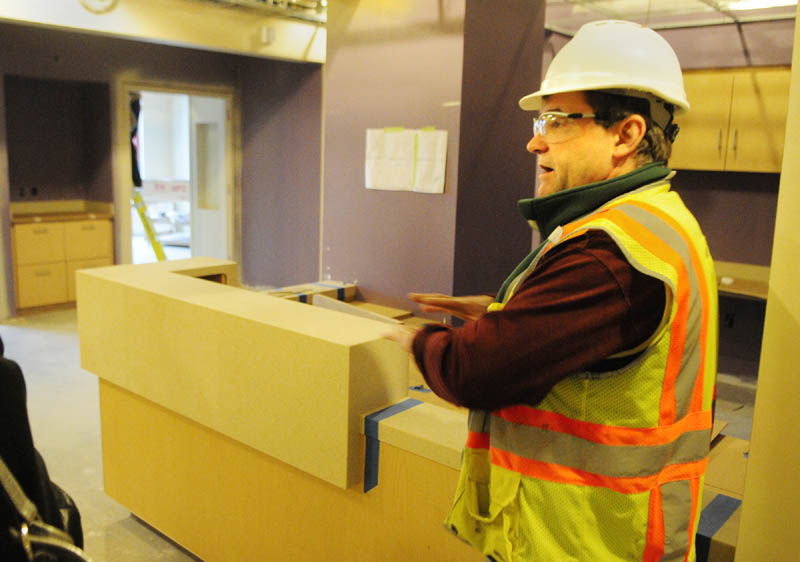 Dan Berube, onsite foreman for Windham Millwork, talks about the cabinets that workers have already installed during a tour on Dec. 4 at the new MaineGeneral regional hospital in Augusta. The cabinets, counters and some other items are pre-made back in the shop at Windham Millworks before being shipped up and installed.