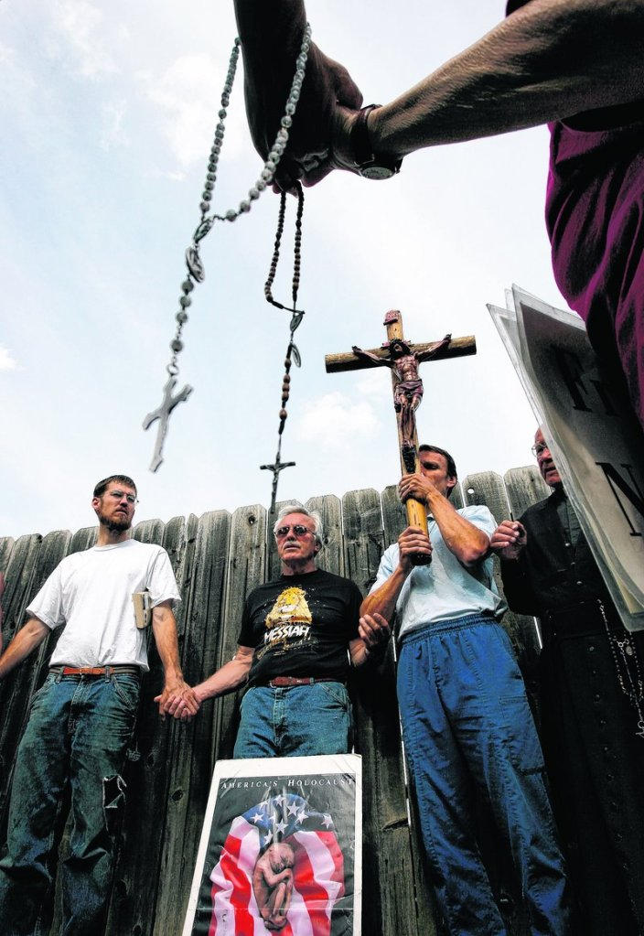 Activists pray outside an abortion clinic in Wichita, Kan., in 2007.