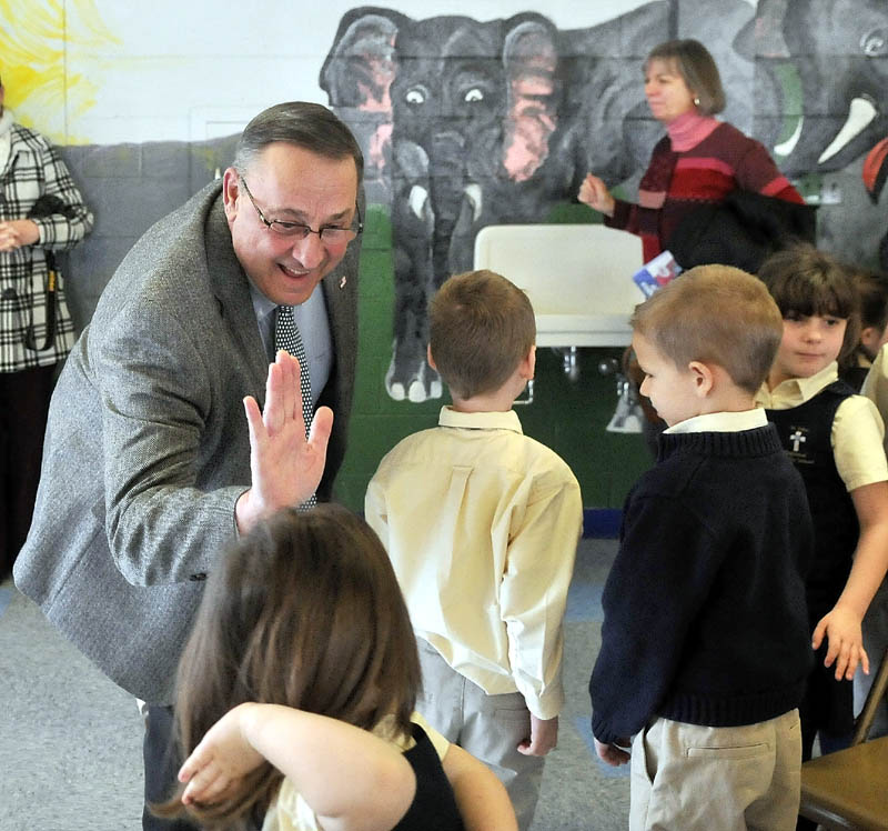 """Gov. Paul LePage greets students after reading """"Baxter at the Blaine House"""" to the student body at St. John Regional Catholic School in Winslow on Friday."""