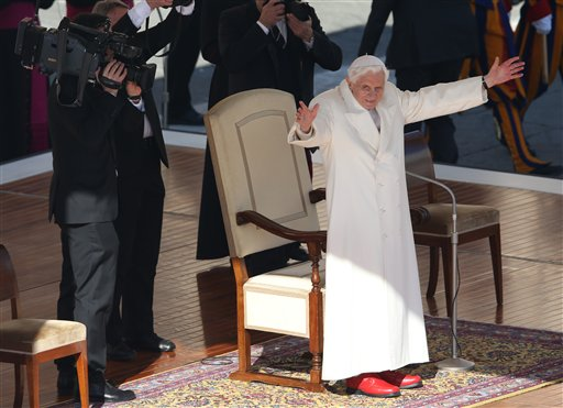 Pope Benedict XVI waves to pilgrims in St. Peter's Square at the Vatican on Wednesday after making several rounds of the square as crowds cheered wildly.