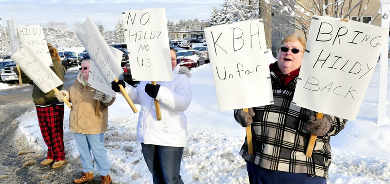 Clients of Kennebec Behavior Health protest outside the Waterville facility on Monday. From left are Brittney Young, Mona Gagnon, Michelle Risinger and Sheila Gaulin. Gaulin said they were upset at the departure of group leader Hildy Curato and chose to protest early Monday as facility managers arrived for a meeting.
