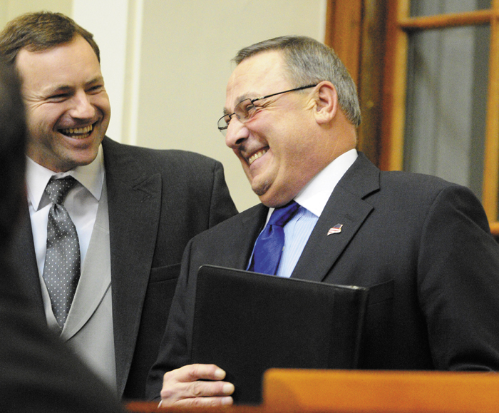 """Gov. Paul LePage, right, chats with Maine Speaker of the House Mark Eves, left, before the governor gives the State of the State address on Tuesday February 5, 2013 in the State House in Augusta. A conservative think tank says Gov. Paul LePage's two-year budget contains a """"subtle tax increase,"""" despite LePage's pledge to not raise taxes."""