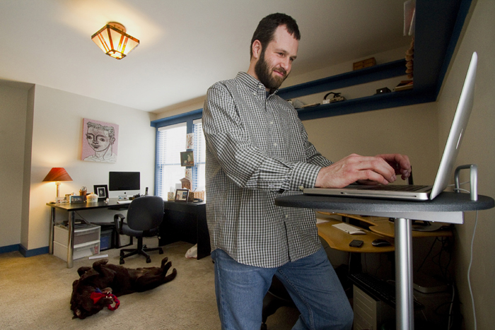 More and more people are telecommuting, working remotely from home, like Mike MacDonald, of Cape Elizabeth, who works in his home office on Friday.