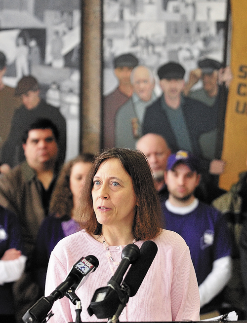 Dawn Kliphan, of Manchester, speaks during a news conference, held by the Maine State Employees Association, on Tuesday in the Cultural Building atrium in Augusta.