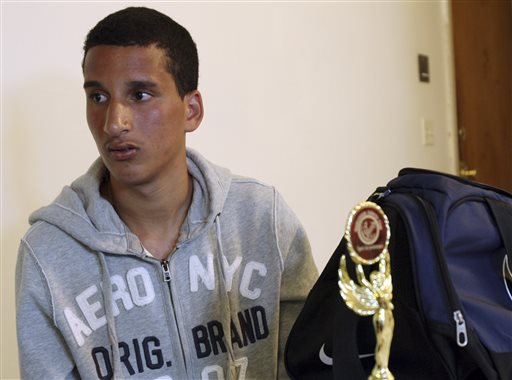 Salah Eddin Barhoum, 17, sits in his apartment in Revere, Mass., on Thursday with one of the trophies he won in an athletic competition, and the bag he was carrying on Monday near the finish line of the Boston Marathon. The high school student, of Moroccan descent, said he is scared to go outside after he was portrayed on the Internet and on the front page of the New York Post as connected to the deadly Boston Marathon bombings.