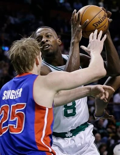 Boston Celtics forward Jeff Green (8) drives against Detroit Pistons guard Kyle Singler (25) in the first half of an NBA basketball game, Wednesday, April 3, 2013, in Boston. (AP Photo/Elise Amendola) TD Garden