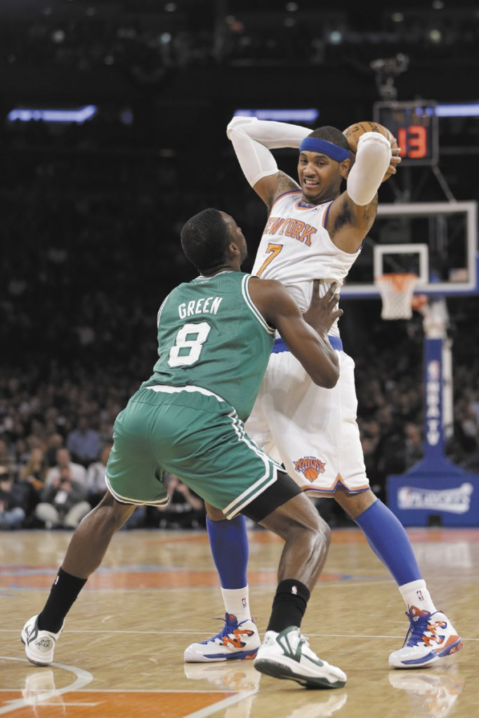 PRESSURE IS ON: Boston Celtics' forward Jeff Green, left, defends New York Knicks' forward Carmelo Anthony in the first half of Game 2 of their first-round NBA playoff series. The Celtics are down 0-2 as the series heads back to Boston.