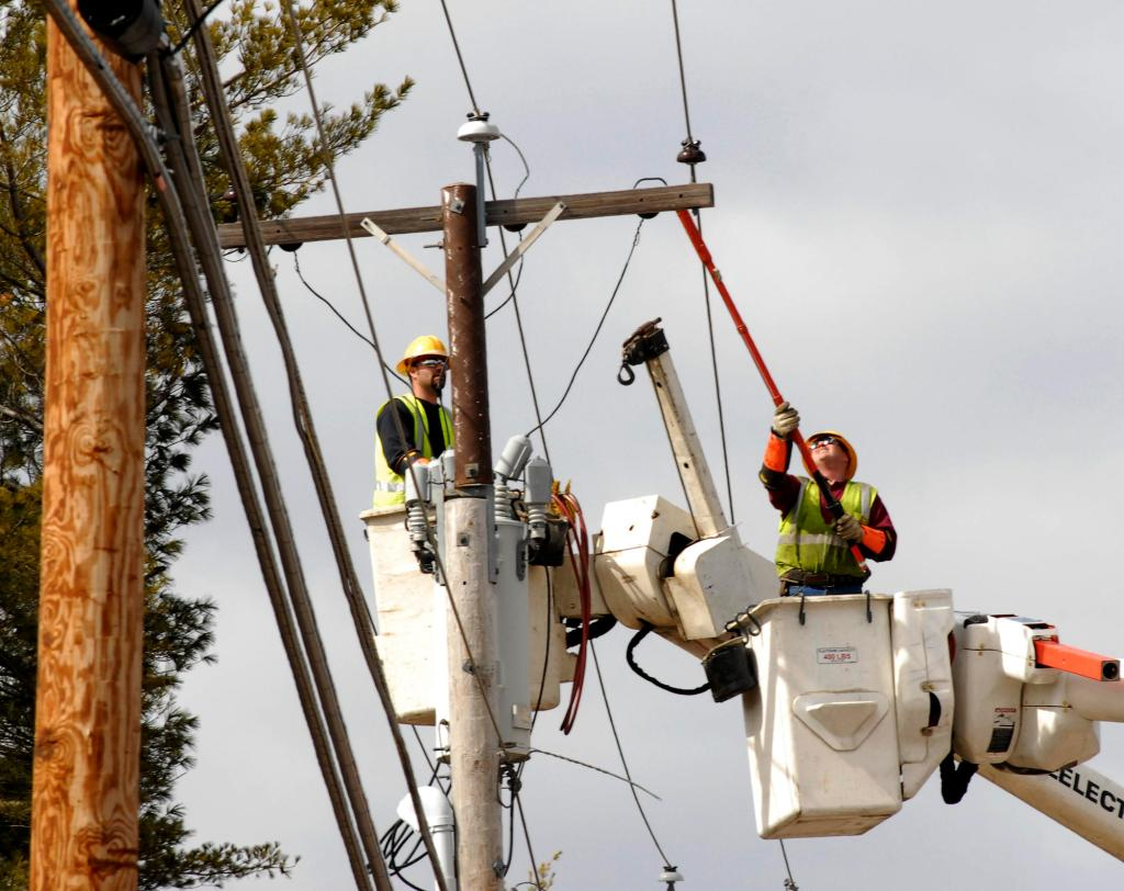 Central Maine Power Co. workers check out a transformer along Route 26 in Gray in March 2010. The company said as many as 5,100 job applicants who used their website may have had their personal information stolen by a hacker.