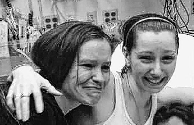 Amanda Berry, right, hugs her sister, Beth Serrano, after being reunited in a hospital Monday. Berry and two other women were found after being missing for about a decade.