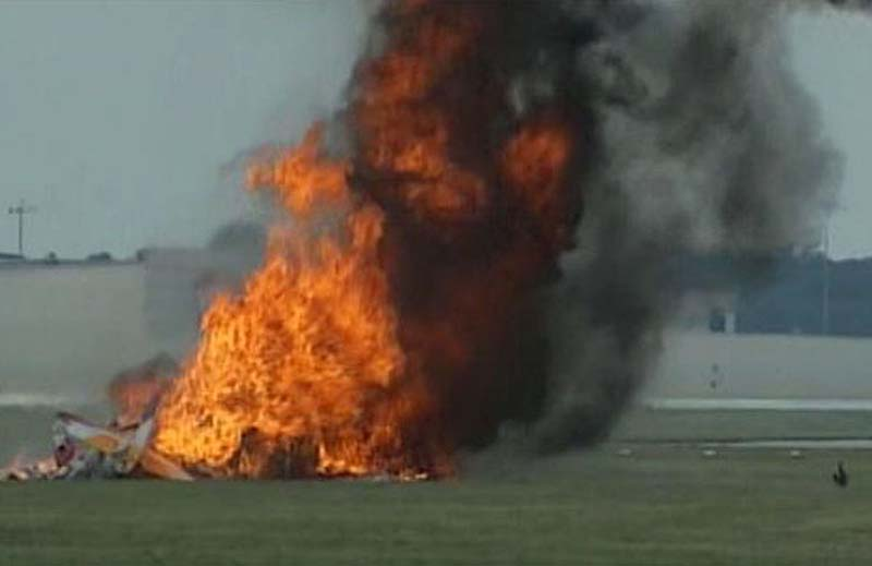 This photo provided provided by WHIO TV shows a plane after it crashed Saturday at the Vectren Air Show near Dayton, Ohio. There was no immediate word on the fate of the pilot, wing walker or anyone else aboard the plane. No one on the ground was hurt.