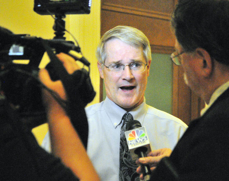 Sen. Patrick Flood, R-Winthrop, talks to reporters outside the Appropriations Committee room on Friday at the State House in Augusta.