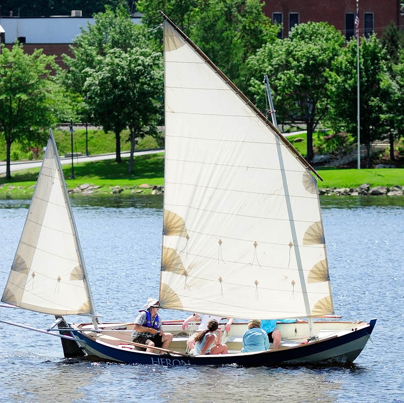 A sailboat in the Kennebec River goes past the Gardiner landing on Saturday, near where the Cobbossee Stream joins the river. There was a light breeze on the hot sunny afternoon.