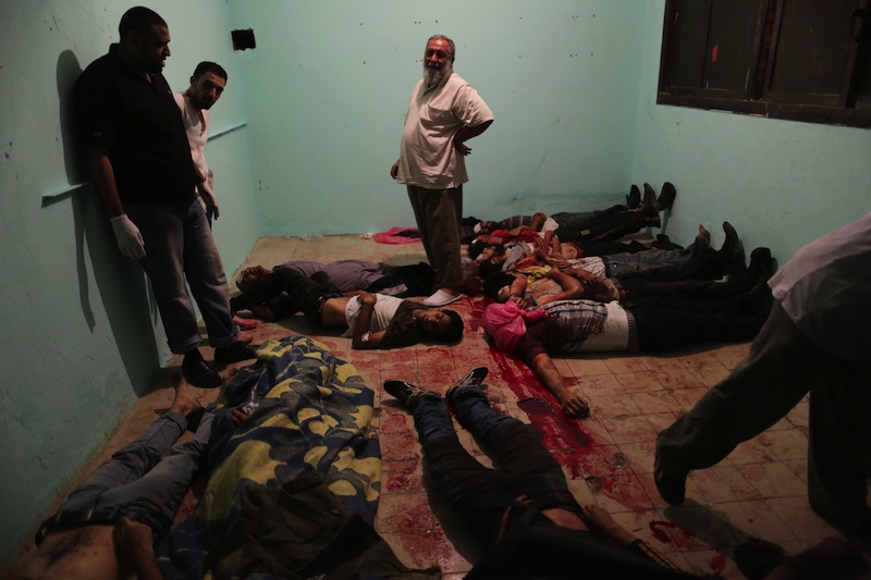 Bodies lie in a room of a hospital after shooting happened at the Republican Guard building in Nasr City, Cairo, Monday, July 8, 2013. Egyptian soldiers and police opened fire on supporters of the ousted president early Monday in violence outside the military building in Cairo where demonstrators had been holding a sit-in, government officials and witnesses said. (AP Photo/Wissam Nassar)