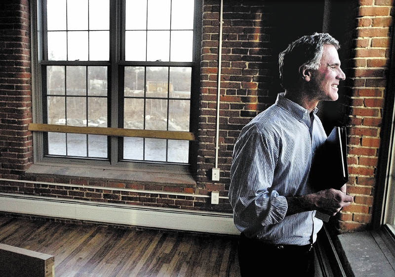 Developer and Colby College alumnus Paul Boghossian enjoys the view of the Kennebec River from one of the apartments in the Hathaway Creative Center in Waterville.