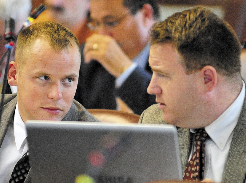Rep. Corey Wilson, R-Augusta, left, chats with Rep. Jarrod Crockett, R-Betherl, during a House session on June 18 in the State House in Augusta.