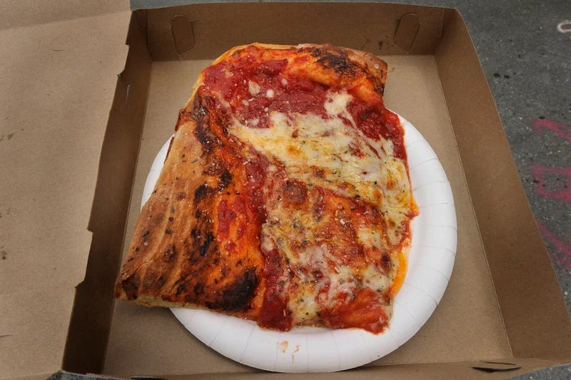 Micucci's Grocery on India Street in Portland is well known for the Sicilian Slab pizza developed by fired baker Stephen Lanzalotta.