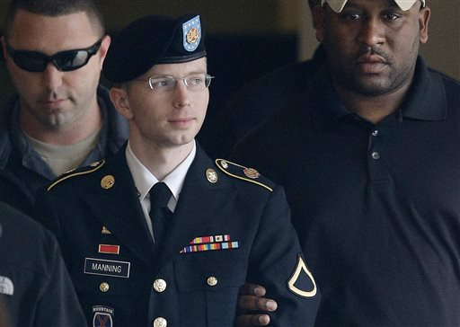 Army Pfc. Bradley Manning is escorted to a security vehicle outside a courthouse in Fort Meade, Md., in this Aug. 20, 2013, photo. He has since changed his name to Chelsea.