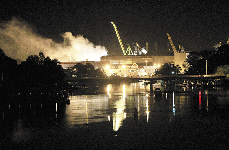 Smoke rises from a Portsmouth Naval Shipyard dry dock as fire crews respond Wednesday, May 23, 2012 to a fire on the USS Miami submarine at the Portsmouth Naval Shipyard on an island in Kittery, N.H. (AP Photo/The Herald, Ionna Raptis)