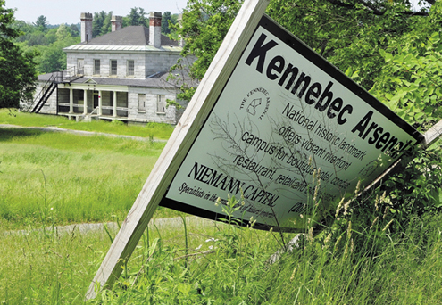 The Niemann Capital sign, next to the north gate of the Kennebec Arsenal, is seen half fallen over in this 2011 file photo.