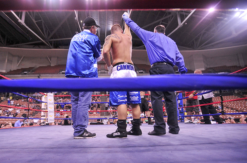 """Brandon """"The Cannon"""" Berry defeated Jesus Javier Cintron 47 seconds in to the third round by disqualification for low blows by Cintron at the 12th annual Fight to Educate boxing show at the Verizon Wireless Arena in Manchester, NH., on Thursday."""