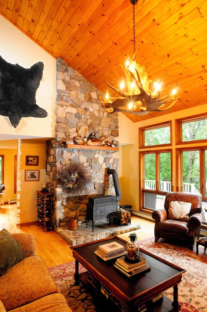 This is the living room, which features a moose antler chandelier and a hanging bear skin at the home of Bruce and Susan Burleigh as seen on Tuesday during a preview for the Homes of Wayne tour that will be held this Saturday. The event is a fundraiser for the Wayne Community Church and the Cary Memorial Library. Tickets are available at the library.