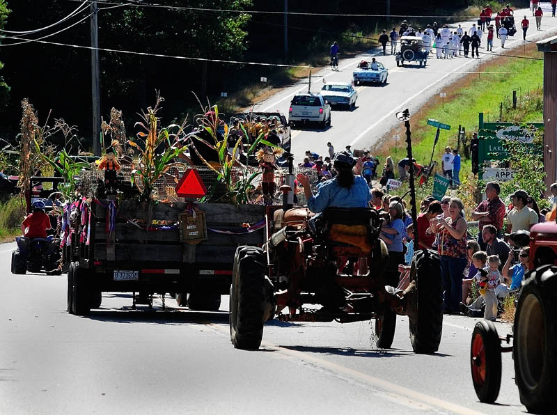 People watch at Lakeside Orchards as the 10th annual Manchester Apple Festival parade goes past on Saturday, on Route 17 in Manchester.